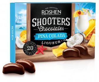 Цукерки Shooters Pina colada Цукерки у чорному шоколаді з кокосовим лікером та ананасовим соком. Рошен